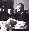 Mohammad Reza Shah and his newborn son, Crown Prince Reza.jpg