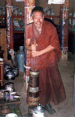 Monk churning butter tea.JPG