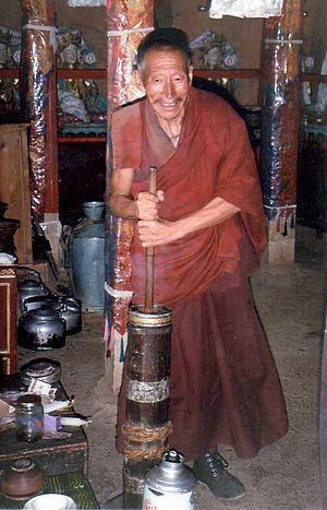 Butter tea - Image: Monk churning butter tea
