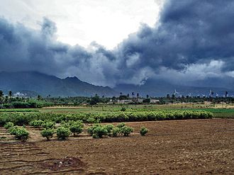 Monsoon - Advancing monsoon clouds and showers in Aralvaimozhy, near Nagercoil, India