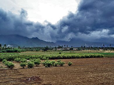 Advancing monsoon clouds and showers in Aralvaimozhy, near Nagercoil, India Monsoon clouds near Nagercoil.jpg