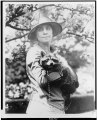 Mrs. Calvin Coolidge, half-length portrait, standing, facing front, holding her pet raccoon Rebecca LCCN90714615.tif