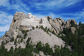 Memorials to Abraham Lincoln - Mount Rushmore, showing the full size of the mountain and the scree of rocks from the sculpting and construction