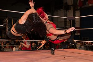 Nikki Cross - Cross performing a swinging fisherman's neckbreaker on LuFisto