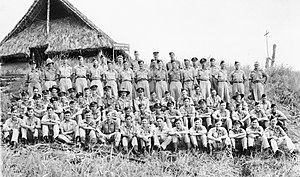 No. 100 Squadron RAAF - No. 100 Squadron aircrew outside their headquarters hut on Goodenough Island in 1944