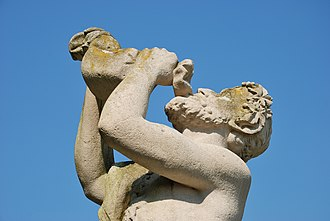 Drinking - The act of drinking portrayed in statuary—the figure employs a traditional waterskin.
