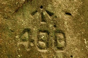 Broad arrow - Benchmark of c.1829 on the line of the Great North Road, Sydney, Australia