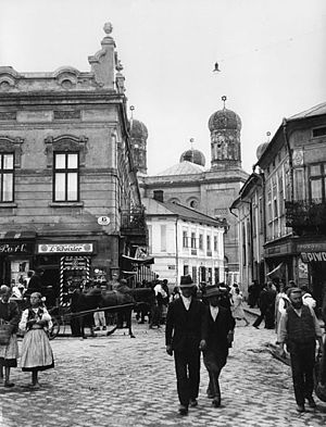 Stanisławów Ghetto - Jewish neighbourhood before World War II with store signs in Polish and the Reform Tempel Synagogue in the background