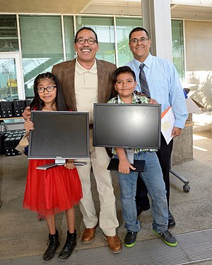 Herb Wesson - Wesson gives L.A. families computers at an OurCycle L.A. event.