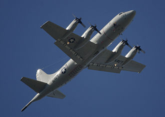 Lockheed P-3 Orion - Underside view of a P-3C showing the MAD (rear boom) and external sonobuoy launch tubes (grid of black spots towards the rear)