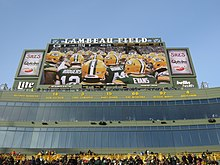 A photo of the part of Lambeau field that shows all of the Packers' retired numbers and player names.