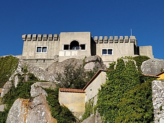 Sanctuary of Peninha - View of the Sanctuary of Peninha, near Sintra in Portugal. The chapel of Nossa Senhora da Peninha is in the foreground with the 20th Century house (or palace) on the hill above.