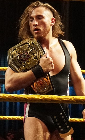 Pete Dunne (wrestler) - Dunne with the WWE United Kingdom Championship in June 2018
