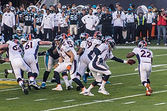 2015 Denver Broncos season - Peyton Manning handing the ball off to C.J. Anderson at Super Bowl 50
