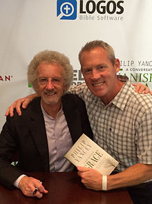 Philip Yancey at a book signing with a fan in 2014
