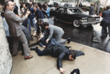 Photograph of chaos outside the Washington Hilton Hotel after the assassination attempt on President Reagan (white border removed).png