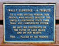 Plaque for Wally Eldredge in a bench by the swimming area at Lake Marie in Umpqua Lighthouse State Park.jpg