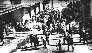 Museo de la Masacre de Ponce - Photojournalist's picture of the actual massacre event, on Marina and Aurora streets, with Casa de la Masacre in the background.
