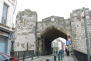 Caernarfon town walls - The East Gate, showing a mixture of medieval, 18th and 19th century architecture