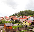Postojna - buildings and hill.jpg