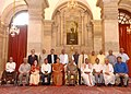 Pranab Mukherjee with the recipients of Hindi Sevi Samman Yojana Award for the Years 2010 and 2011, at Rashtrapati Bhavan, in New Delhi. The Union Minister for Human Resource Development, Smt. Smriti Irani is also seen.jpg