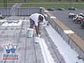 Prepping a Metal Roof To Take a Commercial Roof Coating.jpg