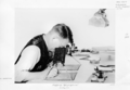 Queensland State Archives 4261 Draughtsman using stereoscope in topographical mapping c 1949.png