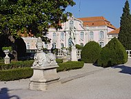 Queluz Palace sphynx statue and ballroom wing.JPG