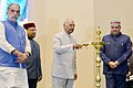 "Ram Nath Kovind lighting the lamp at the presentation of the ""National Awards for the Empowerment of Persons with Disabilities (Divyangjan), 2017"", on the occasion of the ""International Day of Persons with Disabilities"".jpg"