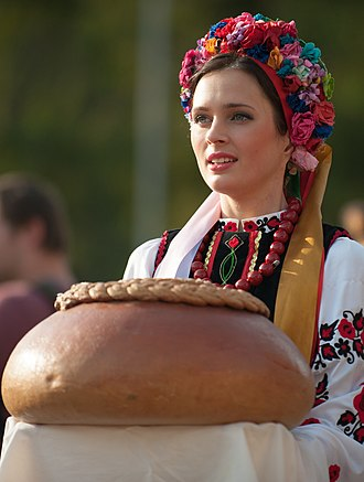 A Ukrainian woman in national dress welcoming with bread and salt Rapid Trident 2014 03.jpg