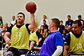 Retired U.S. Navy Chief Gunner's Mate Hector Varela, left, passes the ball during a wheelchair basketball game against the Air Force team during the Wounded Warrior Pacific Invitational at Joint Base Pearl 140109-N-HA927-006.jpg