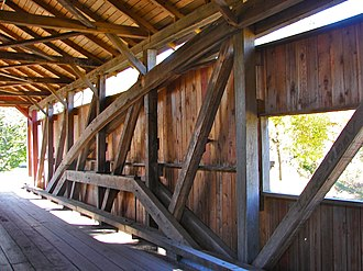 Rice Covered Bridge - Interior, showing the rare combination of queen post and Burr arch trusses.