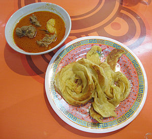 Curry goat - Roti cane served with kari kambing (goat meat and potato curry), in an Aceh Restaurant, Indonesia.
