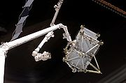 STS-116 - P5 Truss hand-off to ISS (NASA S116-E-05765)