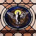 Saint Joseph Church (Plain City, Ohio) - interior, stained glass, the Holy Spirit as a dove.jpg