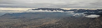 Albuquerque International Sunport - The Sandia Mountains sticking out above the clouds, viewed on takeoff from ABQ