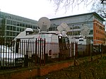 File:Sat trucks by Forbury Gardens, Reading (114157952).jpg