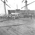 Schooner LUCILE loading supplies from a dock in Seattle, Washington, February 15, 1898 (KIEHL 193).jpeg