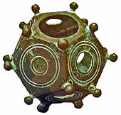 Photograph of a bronze dodecahedron recovered from the ancient Roman Empire, described in the text.