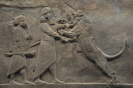 Part of the Lion Hunt of Ashurbanipal, c. 645–635 BC Sculpted reliefs depicting Ashurbanipal, the last great Assyrian king, hunting lions, gypsum hall relief from the North Palace of Nineveh (Irak), c. 645-635 BC, British Museum (16722368932).jpg