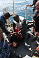 Senior Chief Boatswain's Mate Bryant, center, teaches deck division Sailors how to handle an unconscious victim during a man overboard drill aboard 100529-N-7699S-011.jpg
