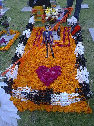 Tagetes - Marigolds decorating a grave for Day of the Dead in Mexico