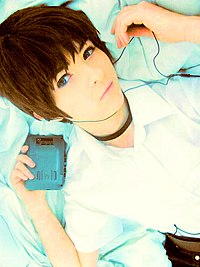 Shinji Ikari cosplayer with personal cassette player 20160116.jpg
