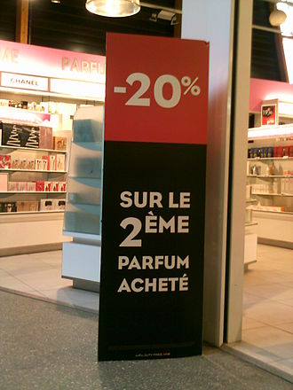 Subtraction - Placard outside a shop in Bordeaux advertising subtraction of 20% from the price of a second perfume.