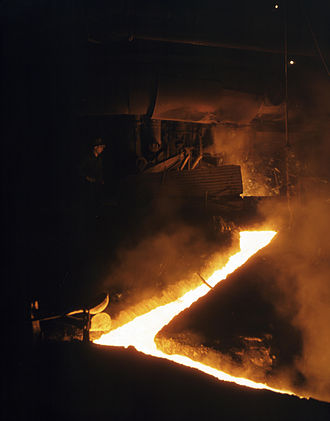 Slag - Slag run-off from one of the open hearth furnaces of a steel mill, Republic Steel, Youngstown, Ohio, November 1941. Slag is drawn off the furnace just before the molten steel is poured into ladles for ingotting.