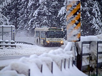 Mendenhall Valley, Juneau - A Capital Transit System bus approaching the Mendenhall River bridge on Mendenhall Loop Road in December 2012.  This bridge marks the farthest crossing upriver.