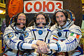 Soyuz TMA-09M crew in front of their spacecraft.jpg