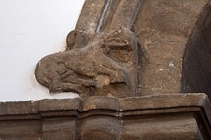 St Bene't's Church - Image: St Benet's arch carving L