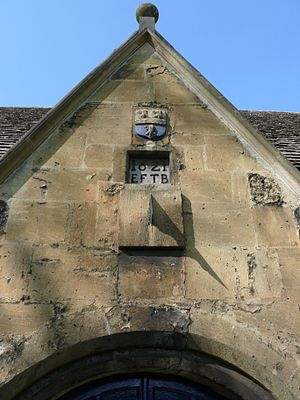 St Thomas the Martyr's Church, Oxford - The gable of the south porch. Note date of 1621, and the arms of Dr Burton.