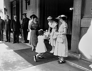 Curtsey - Presenting flowers to Queen Elizabeth II outside Brisbane City Hall in March 1954